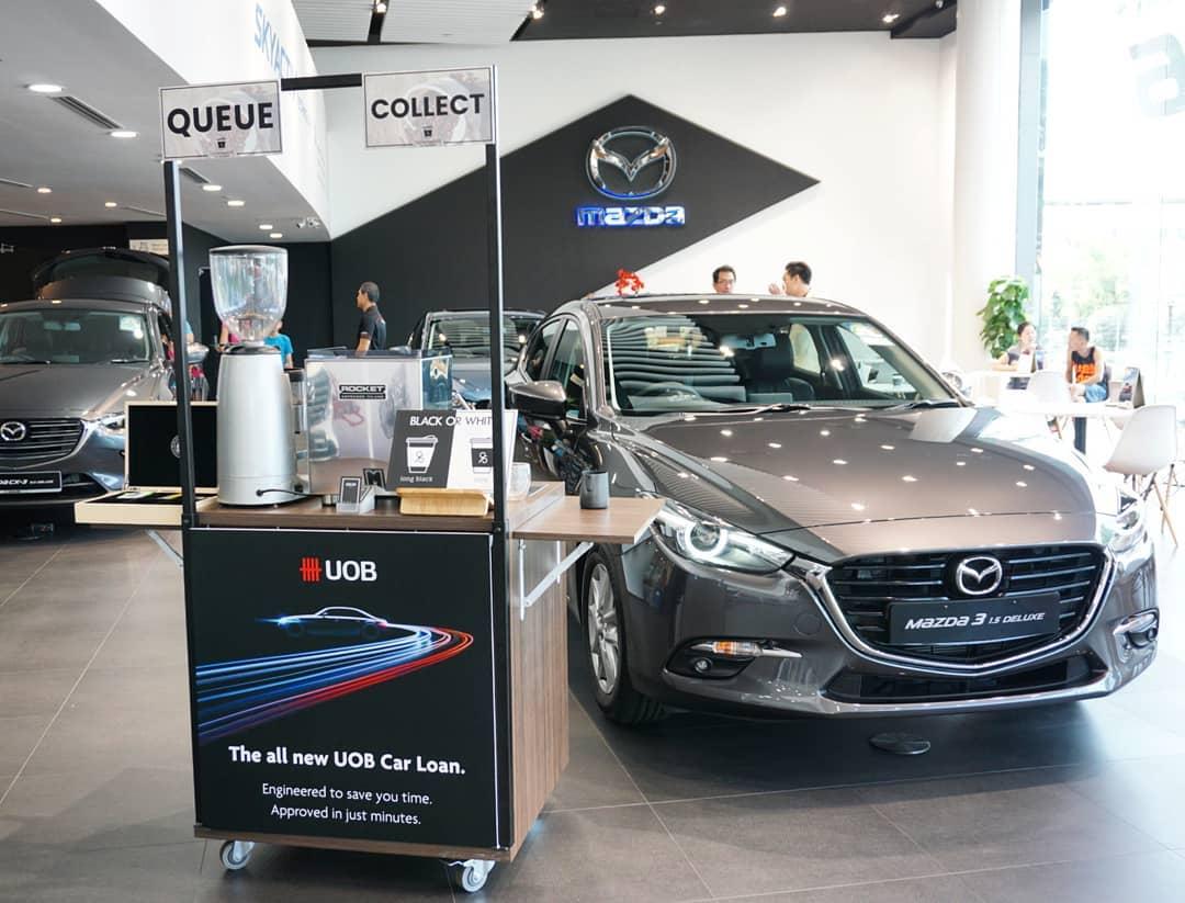 UOB Cart Branding at Mazda Showroom